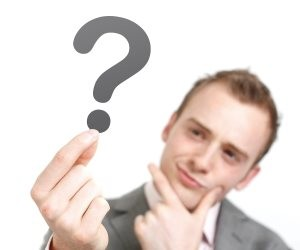 Man-holding-question-mark